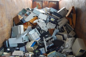 Image of computers in a skip