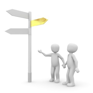 Image of 2 characters looking at a signpost