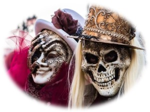 Image of 2 carnival goes wearing skeleton masks and hats. The image has soft edges and no border.